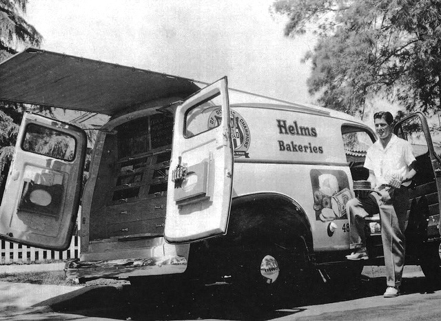 Helms Bakeries trucks deliver the goods to suburbia in the 1950's. (Can you find the yummy chocolate layer cake in plain view? Yum.)